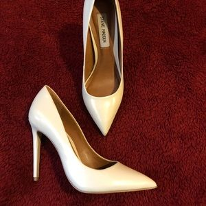 White pointed toe pumps